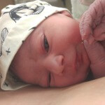 newborn with a hat