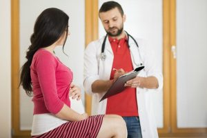 young-pregnant-woman-with-doctor-in-hospital